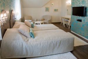 Elegante Zimmer und Suiten)
